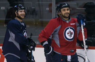 Winger Michael Frolik and blue-liner (some times) Dustin Byfuglien like what they see at Monday's Winnipeg Jets practice. The team's brass also likes what it sees, as far as the lineup is concerned.