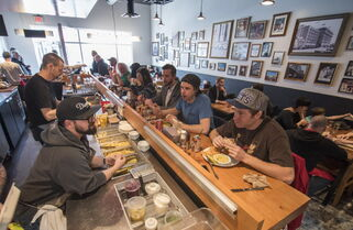 Customers chow down on eastern European-inspired fare prepared by chef Jon Hochman (left) at Sherbrook Street Delicatessen.