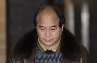 Diran Lin, father of Jun Lin, is shown at the Montreal Courthouse on the sixth day of jury deliberations in the murder trial for Luka Rocco Magnotta, Sunday, December 21, 2014. Magnotta is charged in connection with the death and dismemberment of university student Jun Lin in a case that made international headlines. THE CANADIAN PRESS/Graham Hughes