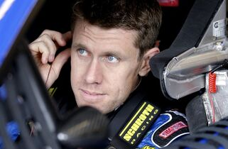 Driver Carl Edwards sits in his car in the garage during a practice for the NASCAR Sprint Cup Series auto race at Chicagoland Speedway in Joliet, Ill., Friday, Sept. 12, 2014. (AP Photo/Nam Y. Huh)
