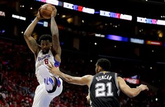 Los Angeles Clippers center DeAndre Jordan, left, is fouled by San Antonio Spurs forward Tim Duncan during the second half of Game 1 of a first-round NBA basketball playoff series in Los Angeles, Sunday, April 19, 2015. (AP Photo/Chris Carlson)