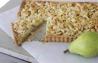This Sept. 8, 2014 photo shows lemon verbena pear tart in Concord, N.H. The slightly sweet, slightly savory, very Italian pear tart can be served at brunch or as a dessert. (AP Photo/Matthew Mead)