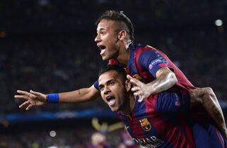 FILE - In this Tuesday, April 21, 2015 file photo Barcelona's Neymar celebrates on the shoulders of teammate Dani Alves, after scoring his second goal during the Champions League quarterfinal second leg soccer match between FC Barcelona and Paris Saint Germain at the Camp Nou Stadium in Barcelona, Spain. (AP Photo/Manu Fernandez, File)