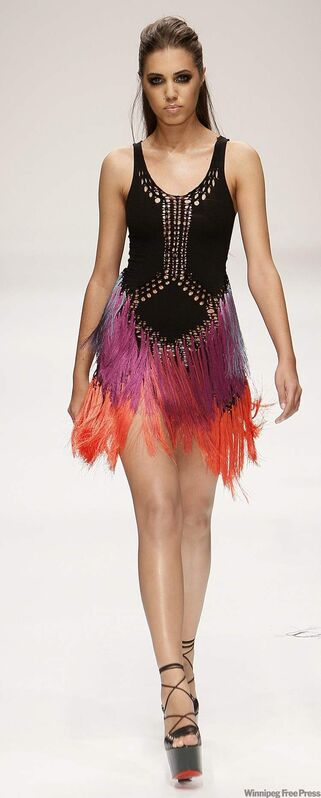 Model Amber Le Bon presents an outfit designed by Manitoba's Mark Fast, at London Fashion Week in London in 2010.