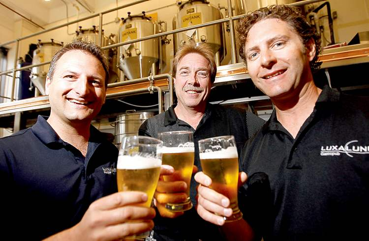 TREVOR HAGAN / WINNIPEG FREE PRESS From left: Chris Warwaruk, Rob McCaig and Lawrence Warwaruk expect to lure thirsty tourists to The Farmery next year.