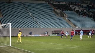 Manchester City players and CSKA players play in front of empty stands during the Champions League Group E soccer match between CSKA Moscow and Manchester City at Arena Khimki stadium in Moscow, Russia, Tuesday Oct. 21, 2014. CSKA have to play 3 matches behind closed doors after as punishment for the bad behaviour of their fans last season. (AP Photo/Ivan Sekretarev)