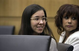 Jodi Arias looks toward family members during the sentencing phase of her retrial at Maricopa County Superior Court, Tuesday, Feb. 24, 2015 in Phoenix. (AP Photo/The Arizona Republic, Mark Henle, Pool)