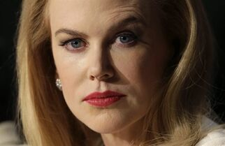 FILE - In this May 14, 2014 file photo, actress Nicole Kidman pauses before answering questions during a press conference for the film Grace of Monaco at the 67th international film festival, Cannes, southern France. Actress Kidman on Tuesday, Sept. 30, 2014, broke her public silence since the death of her father more than two weeks ago by sharing her heartbreak and thanking well-wishers for their comforting thoughts and prayers. (AP Photo/Thibault Camus, File)