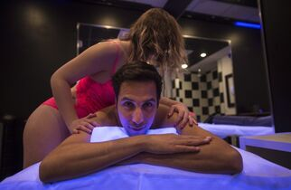 Yanick Chicoine, who operates two erotoc massgae parlours in the city's east end, poses for a photograph in a massage parlour, Wednesday, February 18, 2015 in Montreal. One year after the mayor promised to crack down on erotic massage parlours, Montreal still doesn't know what it's going to do with the hundreds of establishments operating right across the city. THE CANADIAN PRESS/Paul Chiasson