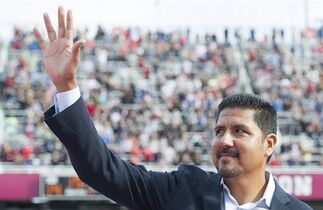 Former Montreal Alouettes quarterback Anthony Calvillo waves to fans in Montreal, Monday, October 13, 2014, prior to a ceremony to retire his jersey during a CFL football game between the Montreal Alouettes and the Saskatchewan Roughriders. THE CANADIAN PRESS/Graham Hughes