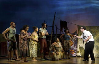 In this file image released by Boneau/Bryan-Brown, Josh Gad, right, performs with an ensemble cast in