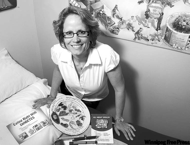Lori Berard, nurse manager at the Diabetes Research Group at the Health Sciences Centre, was Canada's Diabetes Educator of the Year in 2009.Here, Berard displays some of her tools of the trade.
