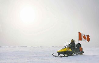 Ranger Joe Amarualik, from Iqaluit, Nunavut, drives his snowmobile on the ice during a Canadian Ranger sovereignty patrol near Eureka, on Ellesmere Island, Nu., in 2007.