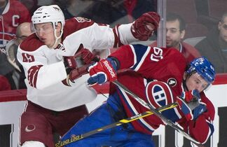 Montreal Canadiens' Christian Thomas, right, collides with Arizona Coyotes' Andrew Campbell during first period NHL hockey action in Montreal, Sunday, February 1, 2015. THE CANADIAN PRESS/Graham Hughes