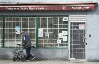 A man walks past the Vancouver Native Health Society in Vancouver, Saturday, March 28, 2015. An accounting firm and new tech outfit have paired to challenge problem-solvers from around the world to generate cost-effective ideas that might prove to be the magic elixir for the health care challenges facing First Nations. THE CANADIAN PRESS/Jonathan Hayward