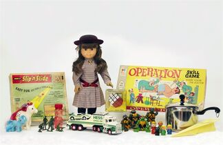 This photo provided by the National Toy Hall of Fame shows the 12 finalists for induction into the 2014 National Toy Hall of Fame. The nominees are Fisher-Price Little People, Hess toy trucks, My Little Pony, Rubik's Cube, Slip 'N Slide, Teenage Mutant Ninja Turtle Toys, American Girl dolls, the game Operation, little green Army men and bubbles, and pots and pans and paper airplanes. Two winners will be inducted on Nov. 6. (AP Photo/National Toy Hall of Fame)