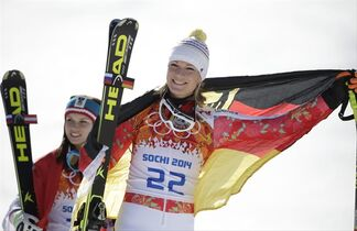 Women's super-G gold medalist Anna Fenninger of Austria, left, and silver medalist Maria Hoefl-Riesch of Germany leave the podium at the Sochi 2014 Winter Olympics, Saturday, Feb. 15, 2014, in Krasnaya Polyana, Russia. (AP Photo/Gero Breloer)