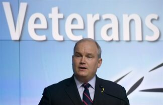 Minister of Veterans Affairs Erin O'Toole speaks during a news conference at the Department of National Defence headquarters in Ottawa, Monday March 30, 2015. THE CANADIAN PRESS/Adrian Wyld