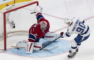 Tampa Bay Lightning's Vladislav Namestnikov scores past Montreal Canadiens goalie Carey Price during second period NHL hockey action Monday, March 30, 2015 in Montreal. THE CANADIAN PRESS/Paul Chiasson