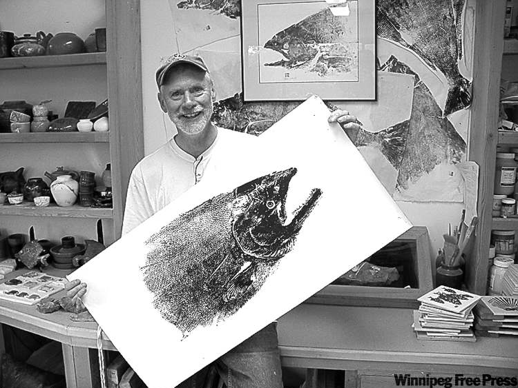 Michael McCarthy / postmedia newsBrian Eccles in his studio in Queen Charlotte City works with �foundmaterials� like salmon he catches.