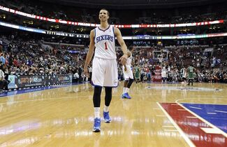 Philadelphia 76ers' Michael Carter-Williams smiles at the crowd towards the end of the second half of an NBA basketball game on Monday, April 14, 2014, in Philadelphia. The 76ers won 113-108. (AP Photo/Michael Perez)