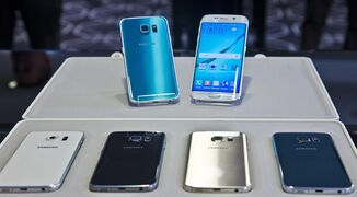FILE- In this Feb. 23, 2015, file photo, two new Samsung phones, Galaxy S6, top left, and Galaxy S6 Edge, to right, are on display with choice of color selections at a special media preview in New York. Orders for Samsung's Galaxy S 6 phones start Saturday, March 28, 2015, with delivery around April 10. (AP Photo/Bebeto Matthews, File)