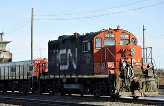 A CN locomotive makes it's way through the CN Taschereau yard in Montreal on Nov., 28, 2009. Canadian National Railway will be fined for failing to comply with an order that it move a minimum amount of grain each week, a spokeswoman for federal Transport Minister Lisa Raitt said Wednesday in a move that caught the railway by surprise. THE CANADIAN PRESS/Graham Hughes