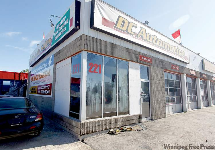 Broken glass and melted insulation are visible at DC Automotive on St. Mary's Road on Sunday after two men allegedly threw Molotov cocktails at the business.
