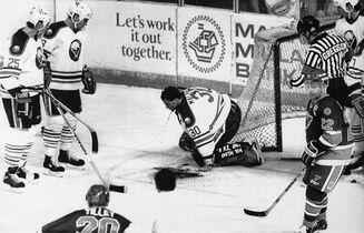 Buffalo Sabres goalie Clint Malarchuk clutches his throat after suffering a lacerated neck in this March 22, 1989 photo in Buffalo, N.Y. Hockey fans will always remember Malarchuk as the NHL goaltender who nearly died in 1989 after a skate blade sliced his jugular vein. He knows that.THE CANADIAN PRESS/AP, Harry Scull Jr.