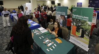 In this photo taken Friday, Feb. 6, 2015, U.S. Armed Forces Veterans attend the annual Veterans Career and Resource Fair in Miami. The Labor Department releases weekly jobless claims for the week ending Feb. 28 on Thursday, March 5, 2015. (AP Photo/Alan Diaz)