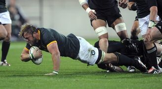 South Africa's Duane Vermeulen is taken in a New Zealand tackle during the Rugby Championship test at Westpac Stadium, Wellington, New Zealand, Saturday, Sept. 13, 2014. (AP Photo/SNPA, Ross Setford) NEW ZEALAND OUT