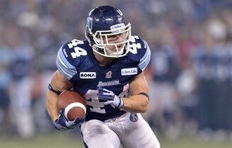 Toronto Argonauts running back Chad Kackert runs the ball during third quarter CFL Grey Cup action against the Calgary Stampeders in Toronto on Sunday, November 25, 2012. Kackert won't be making his return to the Argonauts this weekend against the Edmonton Eskimos.The veteran running back had his first on-field practice with the Argos since being added to the practice roster Saturday.THE CANADIAN PRESS/Nathan Denette