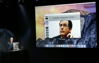 Craig Federighi, senior vice president of Software Engineering at Apple, far left, has a video chat with Stephen Colbert as he discusses the new operating system update during an event at Apple headquarters on Thursday, Oct. 16, 2014 in Cupertino, Calif. (AP Photo/Marcio Jose Sanchez)