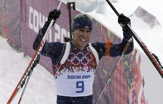 Norway's Emil Hegle Svendsen celebrates after winning the gold in the men's biathlon 15k mass-start, at the 2014 Winter Olympics, Tuesday, Feb. 18, 2014, in Krasnaya Polyana, Russia. (AP Photo/Kirsty Wigglesworth)