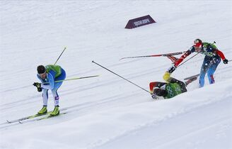 Germany's Tim Tscharnke, center, falls in front of Russia's Nikita Kriukov, right, after making contact with the skis of Finland's Sami Jauhojaervi, left, in the men's classical-style final of the cross-country team sprint competitions at the 2014 Winter Olympics, Wednesday, Feb. 19, 2014, in Krasnaya Polyana, Russia. (AP Photo/Dmitry Lovetsky)