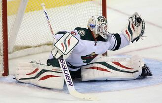 Minnesota Wild goaltender Ilya Bryzgalov makes a glove save during first-period NHL action against the Winnipeg Jets at the MTS Centre in Winnipeg on Monday night.