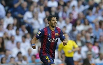 Barcelona's Luis Suarez, celebrates after Barcelona's Lionel Messi scored during a Spanish La Liga soccer match between Real Madrid and Barcelona at the Santiago Bernabeu stadium in Madrid, Spain, Saturday Oct. 25, 2014. (AP Photo/Paul White)