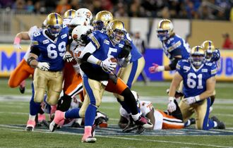 Winnipeg Blue Bombers' quarterback Drew Willy (5) is sacked by BC Lions' Khreem Smith (94) during a game in Winnipeg last season.