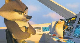 Agent Classified (voiced by Benedict Cumberbatch), and Skipper (voiced by Tom McGrath) in a scene from The Penguins of Madagascar.