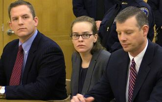 Lacey Spears, flanked by her attorneys David Sachs, left, and Stephen Riebling, Jr., right, looks toward the jury as her guilty verdict is read at the Westchester County Courthouse in White Plains, N.Y., Monday, March 2, 2015. Spears, who blogged for years about her son Garnett-Paul Spears' constant health woes, was convicted of poisoning the 5-year-old to death by force-feeding heavy concentrations of sodium through his stomach tube. (AP Photo/The Journal News, Joe Larese, Pool)