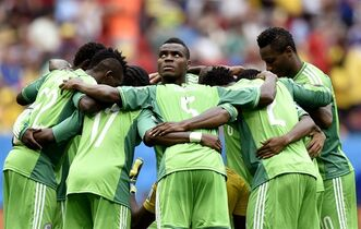 File: In this Monday, June 30, 2014 file photo, Nigeria's Emmanuel Emenike, center, looks up as his team form a huddle before the start of the second half during the World Cup round of 16 soccer match between France and Nigeria at the Estadio Nacional in Brasilia, Brazil. FIFA says it is giving Nigeria one last chance to avoid a