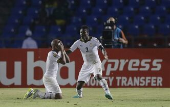 Ghana's Andre Ayew, left, celebrates with teammate Asamoah Gyan, right, after scoring a goal during their African Cup of Nations Group C soccer match in Mongomo, Equatorial Guinea, Tuesday, Jan. 27, 2015. (AP Photo/Themba Hadebe)