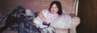 Phoenix Sinclair is seen cradling a cat at around age three.  She was killed by her mother and stepfather at age five.