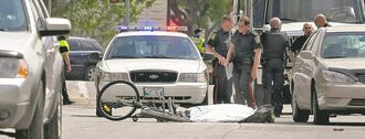 Police didn't say if charges would be laid after a female cyclist was killed on Higgins Avenue near Main Street.