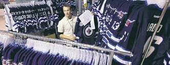 True North employee Reid Paulson with pre-ordered Jets jerseys at the Jets Gear store last October. The fans' enthusiasm hasn't wavered.