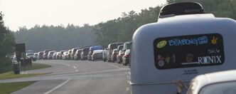 Cars line up as Winnipeg Folk Festival-goers wait for a spot in the Festival Campground Wednesday.