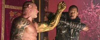 RZA, as Blacksmith, does battle with Brass Body (David Bautista) in The Man With the Iron Fists.