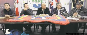 From left, Wasagamack Chief Jerry Knott, Garden Hill Chief Dino Flett, AMC Grand Chief Ron Evans, St. Theresa Point Chief David McDougall and Red Sucker Lake Chief Larry Knott tell media Monday of the need for an all-weather road from Norway House to First Nations in the Island Lake area.