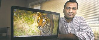 Sanjeev Reddy with a photo taken by his wife during a recent visit to a wildlife sanctuary in India.