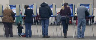 Joe Bryksa / Winnipeg Free Press Grand Forks, N.D., residents vote in the presidential election Tuesday afternoon at the Alerus Centre.